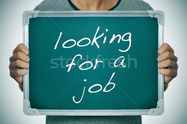 Férfi néz állás tart tábla szöveg Stock fotó © nito
