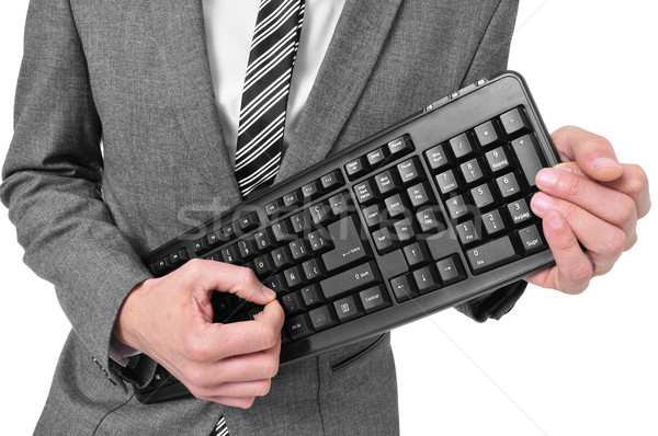 man in suit playing a computer keyboard Stock photo © nito