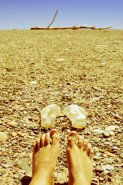 bare feet in a shingle beach Stock photo © nito