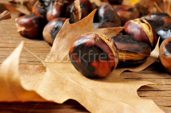 roasted chestnuts and autumn leaves Stock photo © nito
