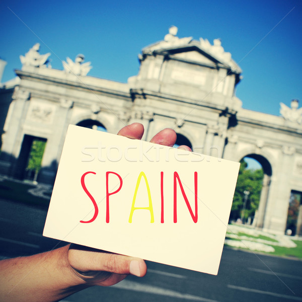 signboard with word Spain and the Puerta de Alcala in Madrid in  Stock photo © nito