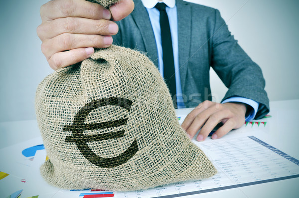 young man in suit with a burlap money bag with the euro sign Stock photo © nito