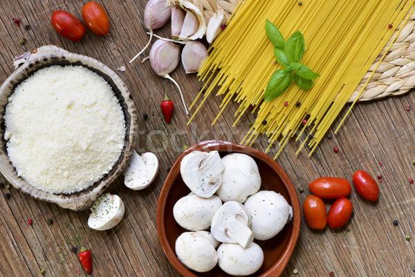 grated cheese, garlics, mushrooms, cherry tomatoes and spaghetti Stock photo © nito