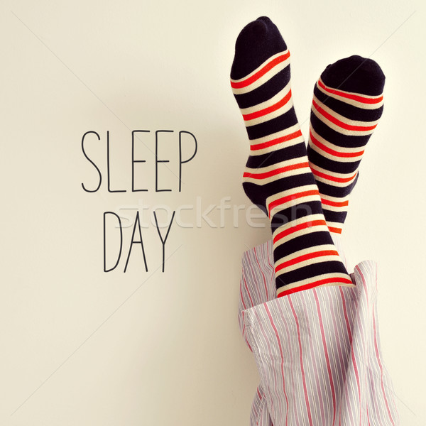 the feet of a man in pajamas and text sleep day Stock photo © nito
