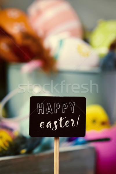 Díszített húsvéti tojások szöveg kellemes húsvétot fekete tábla Stock fotó © nito