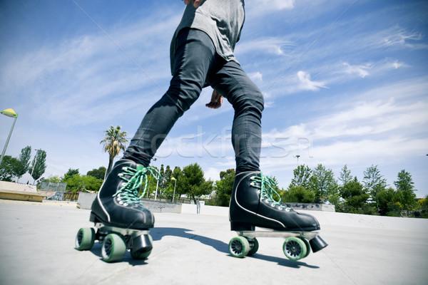 young man roller skating in a skate park Stock photo © nito