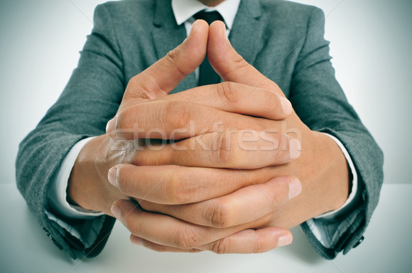 man in suit with clasped hands Stock photo © nito