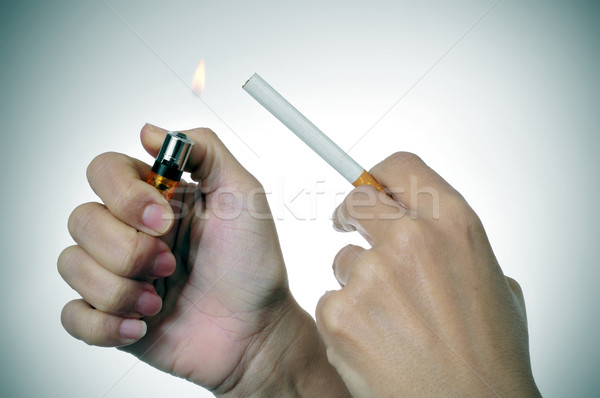 woman lighting a cigarette Stock photo © nito