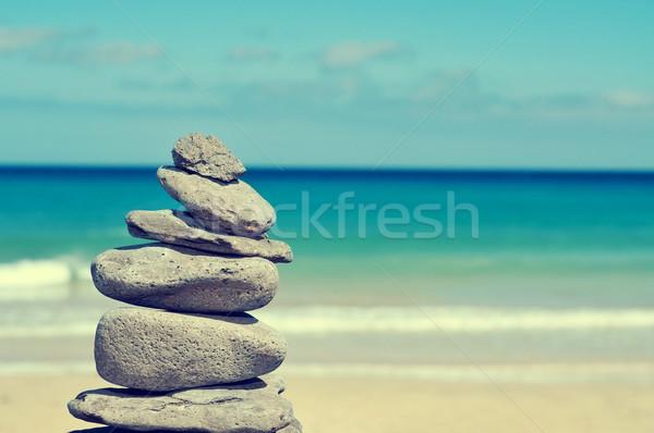 сбалансированный камней пляж лет Сток-фото © nito