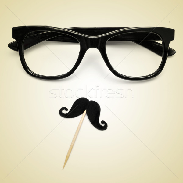eyeglasses and moustache as a hipster guy, with a retro effect Stock photo © nito