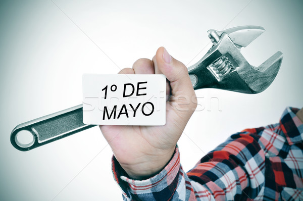 man with adjustable wrench and signboard with text 1o de mayo, m Stock photo © nito