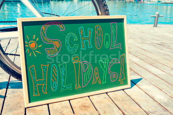 text school holidays written in a chalkboard Stock photo © nito
