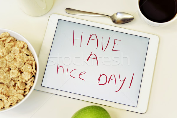 text have a nice day in a tablet Stock photo © nito