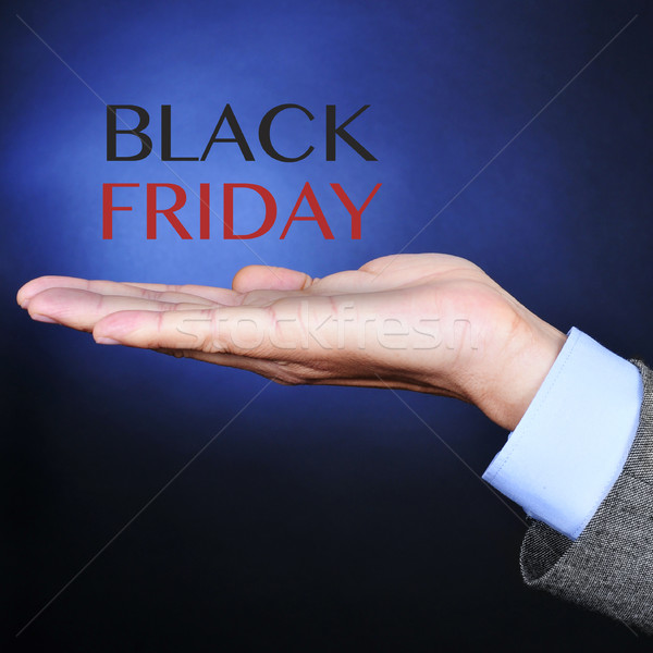 text black friday in the hand of a businessman Stock photo © nito