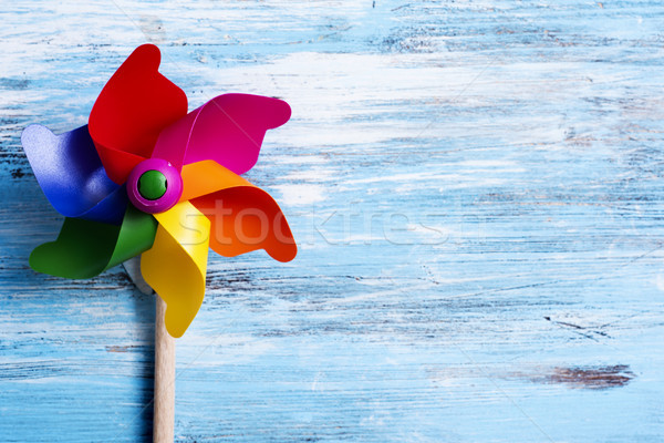 colorful pinwheel on a blue wooden surface Stock photo © nito