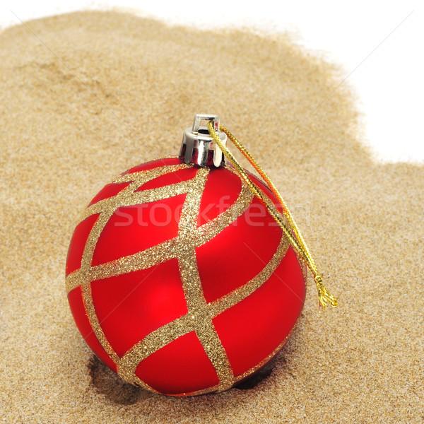 christmas ball on the sand Stock photo © nito