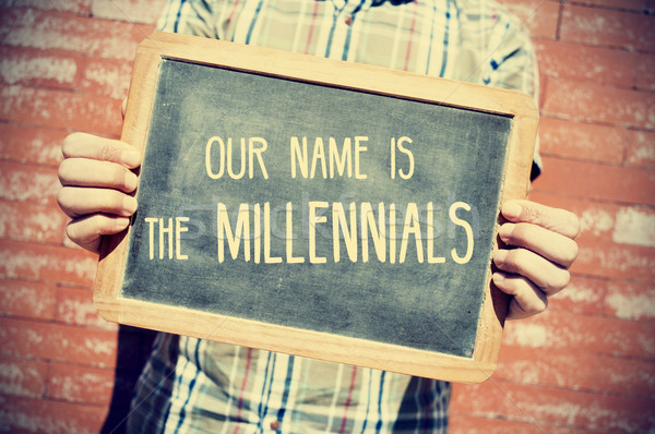 text our name is the millennials in a chalkboard, vignetted Stock photo © nito