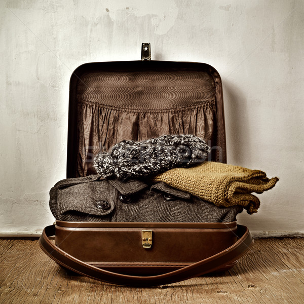 old suitcase with some warm clothing Stock photo © nito