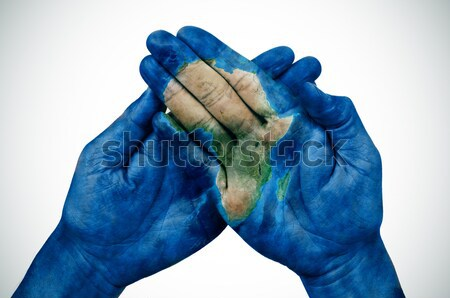 world map and rainbow flag in the hands Stock photo © nito