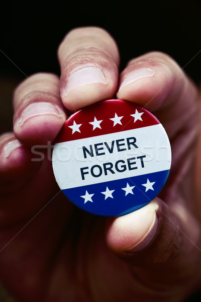 pin button with the text never forget Stock photo © nito