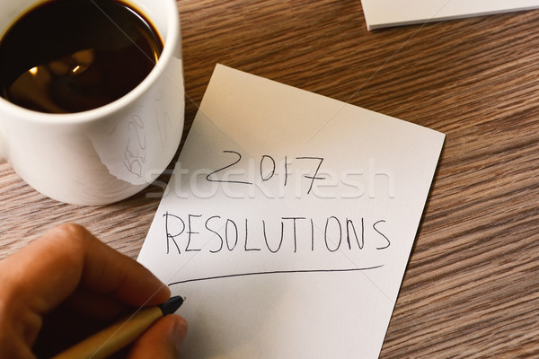 man writting the text 2017 resolutions Stock photo © nito