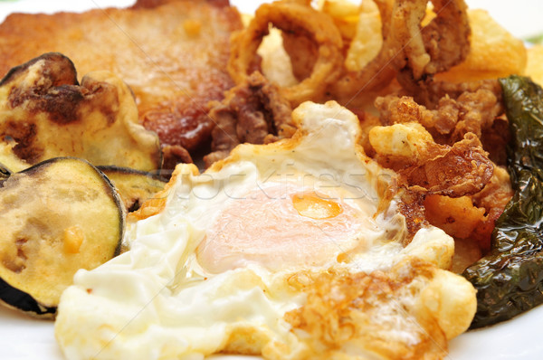 spanish combo platter with fried egg, grilled pepper, fried cala Stock photo © nito
