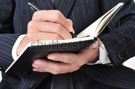 businessman writing in a notebook Stock photo © nito