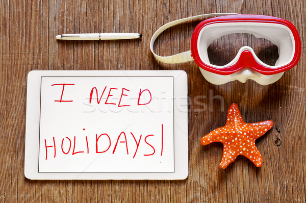 I need holidays in a tablet and a dive mask and a starfish Stock photo © nito