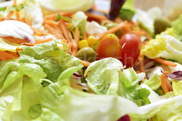 green salad with carrot, olives, cherry tomatoes and sweet corn Stock photo © nito