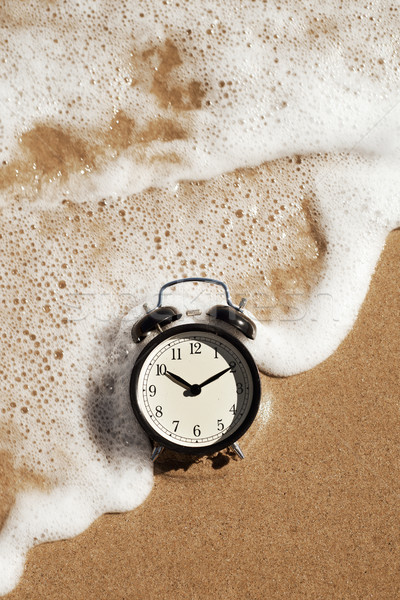 alarm clock on the beach Stock photo © nito