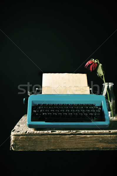 old typewriter and a wilted red rose Stock photo © nito