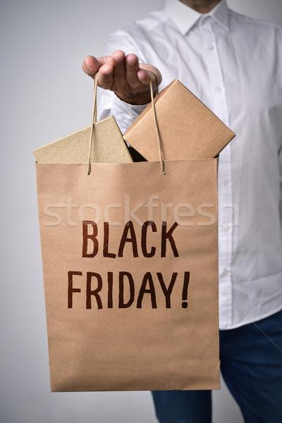 shopping bag full of boxes and text black friday Stock photo © nito