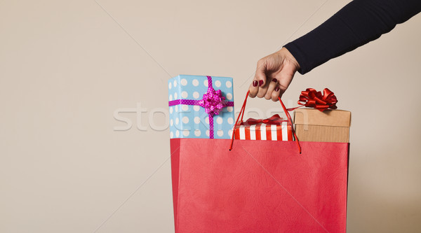 woman with a shopping bag full of gifts Stock photo © nito