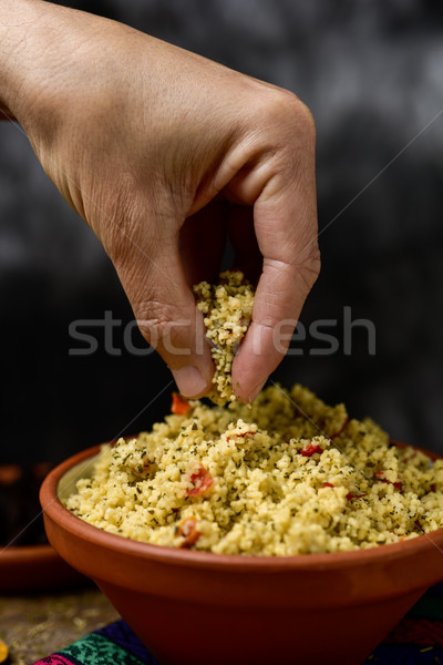 young man eating tabbouleh with his hand Stock photo © nito