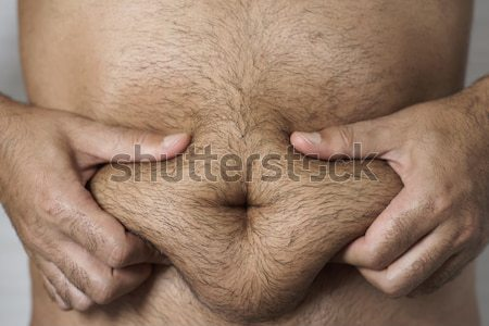 heart in the stomach of a man Stock photo © nito