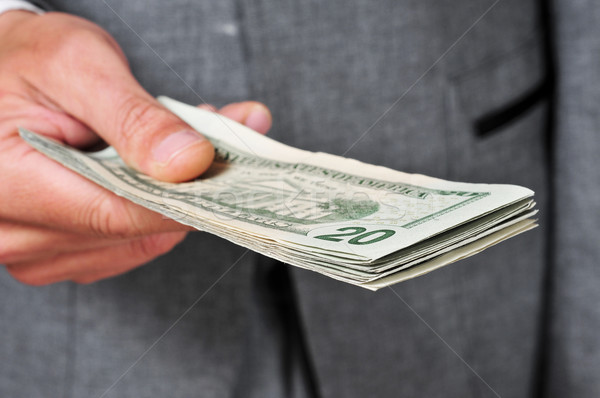 man in suit with a wad of dollars Stock photo © nito