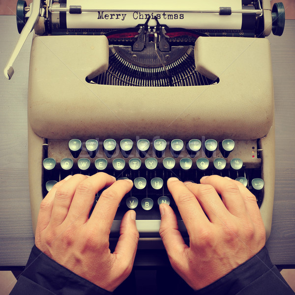 merry christmas typewritten in a paper sheet on a typewriter, wi Stock photo © nito