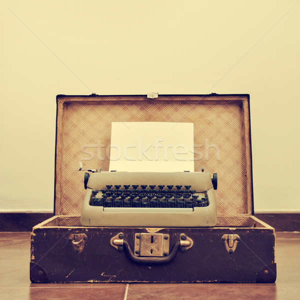 old typewriter in an old suitcase, with a retro effect Stock photo © nito