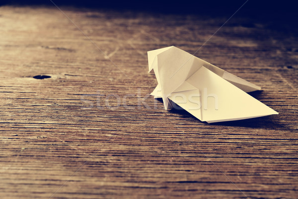 origami bird on a wooden surface, retro effect Stock photo © nito