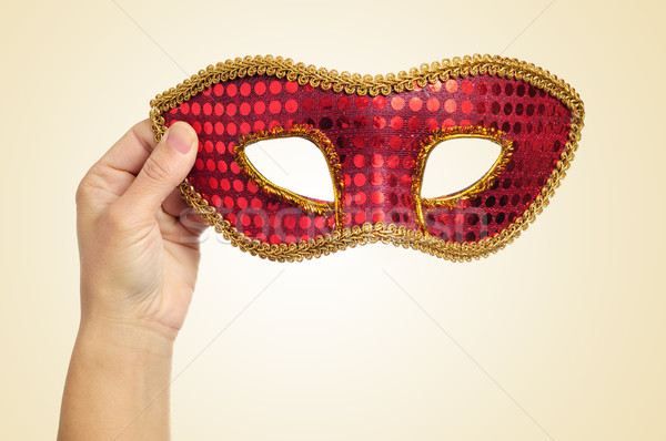 carnival mask in the hand of a young woman Stock photo © nito