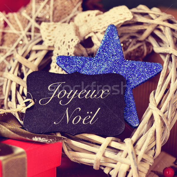 ornaments and text joyeux noel, merry christmas in french Stock photo © nito