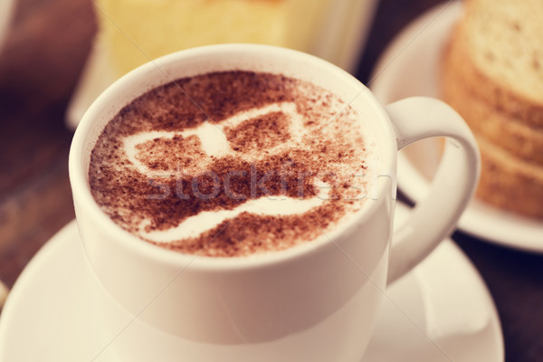 man face in a cup of cappuccino Stock photo © nito