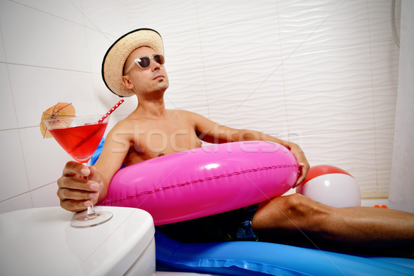 man with a swim ring relaxing in the bathroom Stock photo © nito