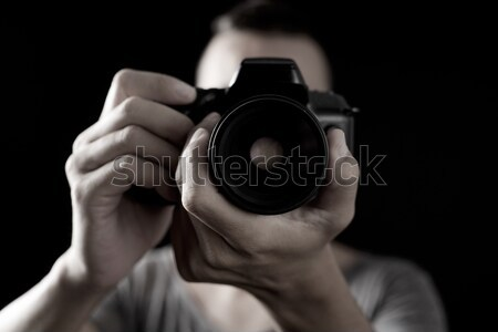 young man with a reflex camera Stock photo © nito