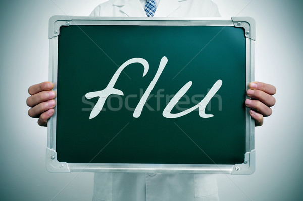 Gripe médico blanco abrigo pizarra Foto stock © nito