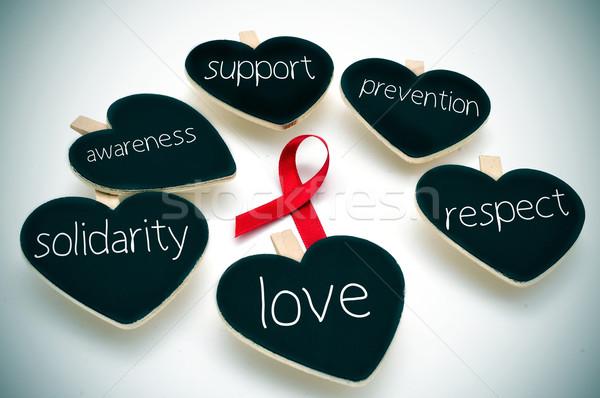 Vörös szalag verekedés AIDS szavak támogatás megelőzés Stock fotó © nito