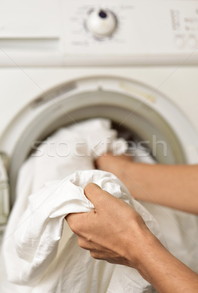 young man doing laundry Stock photo © nito