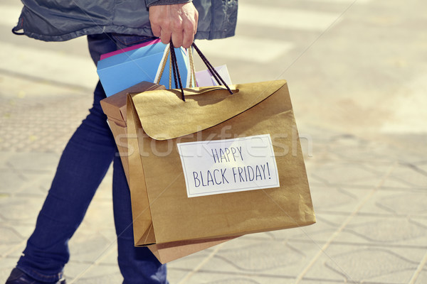 man with a bag with the text happy black friday Stock photo © nito