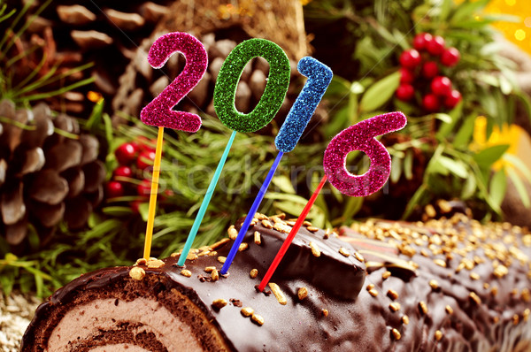 number 2016 on a yule log cake Stock photo © nito