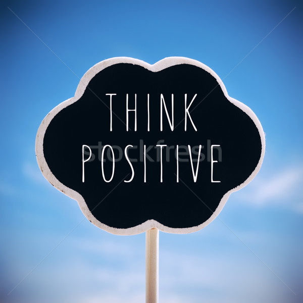 chalkboard with the text think positive, vignetted Stock photo © nito